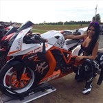 Women KTM 1190 RC8, a man and a woman sitting on a motorcycle a man and a woman sitting on a KTM 1190 RC8 Sportbike