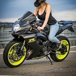 Women Suzuki GSX-R600, a person sitting on a motorcycle a person sitting on a Suzuki GSX-R600 Sportbike