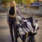 Women BMW S1000RR, a woman riding on the back of a motorcycle a woman riding on the back of a BMW S1000RR Sportbike