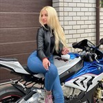 Women BMW S1000RR, a person riding on the back of a motorcycle