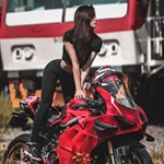 Women Ducati Panigale V4, a woman sitting on a motorcycle