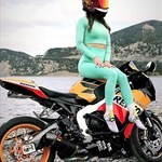 Women Honda CBR1000RR, a motorcycle parked on top of a lush green field a person sitting on a Honda CBR1000RR Sportbike