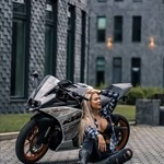 Women KTM 390 series, a motorcycle parked on the side of a building a KTM 390 series Sportbike parked on the side of a building
