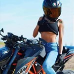 Women KTM Duke Series, a person wearing a helmet and sitting on a motorcycle a person wearing a helmet and sitting on a KTM Duke Series Sportbike