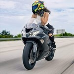 Women Kawasaki Ninja ZX-6R, a person riding on the back of a motorcycle