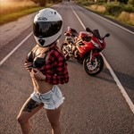 Women Triumph Daytona 675, a person wearing a helmet riding a motorcycle on the side of a road a person wearing a helmet riding a Triumph Daytona 675 Sportbike on the side of a road