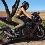Women Yamaha YZF-R6, a person sitting on a motorcycle a person sitting on a Yamaha YZF-R6 Sportbike