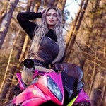 Women Yamaha YZF-R6, a person wearing a helmet sitting on a motorcycle a person wearing a helmet sitting on a Yamaha YZF-R6 Sportbike