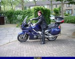 Production (Stock) Yamaha FJR1300, My goodlooking girlfriend posing on her fjr. a person sitting on a 2010 Yamaha FJR1300 sportbike in front of a building