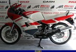 Production (Stock) Yamaha RD200/RD350/RD400, a red and white motorcycle a red and black 1993 Yamaha RD200/350/400 Sportbike