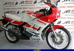 Production (Stock) Yamaha RD200/RD350/RD400, a red and white motorcycle parked a red and white 1993 Yamaha RD200/350/400 Sportbike parked on the side