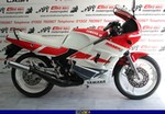 Production (Stock) Yamaha RD200/RD350/RD400, a red and white motorcycle is parked a red and black 1993 Yamaha RD200/350/400 Sportbike is parked on the side