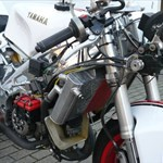 Misc. Racing Yamaha TZ250, a red motorcycle parked in a parking lot a red Yamaha TZ250 Sportbike parked in a parking lot