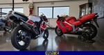 Production (Stock) Yamaha TZR250, 1991 Yamaha TZR 250 SP 6 a red 1991 Yamaha TZR250 parked on the side of a building