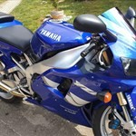 Production (Stock) Yamaha YZF-R1, a motorcycle parked on the side of the road