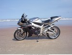 Production (Custom) Yamaha YZF-R1, My R1 on Daytona beach during bikeweek 04 after a long cold winter in CT. But over the winter I did some polishing and sent some things out for chrome. Just looking for comments negative or positive.