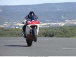 Stunts Yamaha YZF-R1, just to make you feel coming practising in the South of France, this is what we see at the Ledenon race track (near Nimes). The track is anything except flat with plenty of blind curves :-))