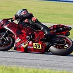 Misc. Racing Yamaha YZF-R1, a person riding a motorcycle on a track a person riding a Yamaha YZF-R1 Sportbike on a track