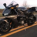 Production (Stock) Yamaha YZF-R1, a motorcycle parked on the side of a road a Yamaha YZF-R1 Sportbike parked on the side of a road