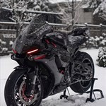 Production (Stock) Yamaha YZF-R1, a motorcycle that is sitting in the snow a Yamaha YZF-R1 Sportbike that is sitting in the snow