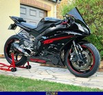 Production (Stock) Yamaha YZF-R6, a motorcycle parked on the side of a building a Yamaha YZF-R6 Sportbike parked on the side of a building