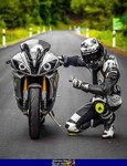 Production (Stock) Yamaha YZF-R6, a person riding a motorcycle on the side of a road a person riding a Yamaha YZF-R6 Sportbike on the side of a road