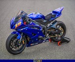 Production (Stock) Yamaha YZF-R6, a motorcycle parked on the side of a road a Yamaha YZF-R6 Sportbike parked on the side of a road