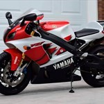 Production (Stock) Yamaha YZF-R7, a red and black motorcycle is parked on the side of a building a red and black Yamaha YZF-R7 Sportbike is parked on the side of a building