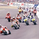 MotoGP Premier Yamaha YZR500, a group of people riding on the back of a motorcycle a group of people riding on the back of a Yamaha YZR500 Sportbike