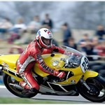 MotoGP Premier Yamaha YZR500, a person riding a motorcycle on a track a person riding a Yamaha YZR500 Sportbike on a track