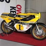 MotoGP Premier Yamaha YZR500, a motorcycle parked on the side of a building a Yamaha YZR500 Sportbike parked on the side of a building