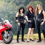 Women Ducati 1199/1299 Panigale, 20161227_090619_ducati panigale donne.JPG a woman standing next to a Ducati 1199/1299 Panigale Sportbike